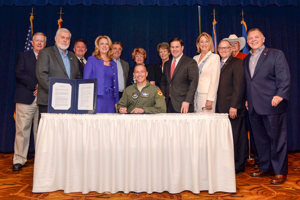 Group image of Air Force personnel and west valley mayors from the June 6, 2016 signature event.